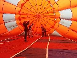 HAWK kids coating the balloon envelope © Eddie Clements, Photographer