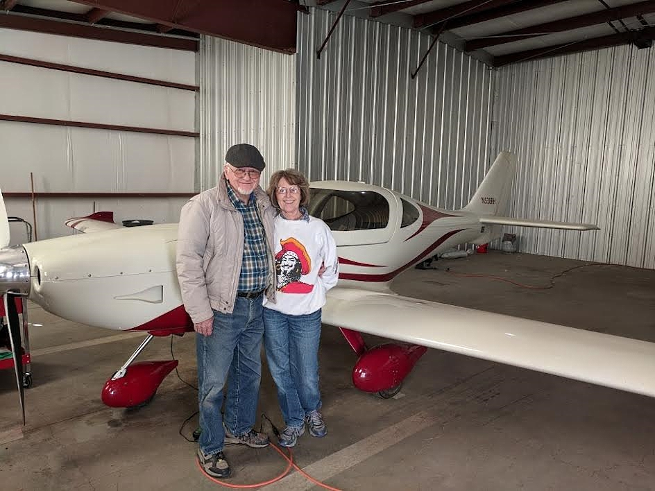 Ron Huddleston and his wife Gail with the Arion Lightening Ron built.