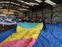The Kids: Christa, Jadin, Lyle's Ryan, and mentor Shay doing a gore by gore inspection on Lyles hot air balloon. Shay's 172 is the one with the cowl covered. Courtesy Eddie Clements, Photographer