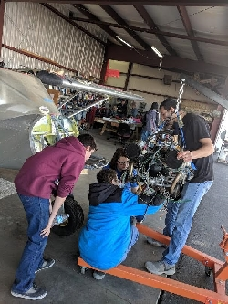 Jake, William M, Kaitlin A, and Mark installing the Rotex engine on the donated Zenith 701 Courtesy Eddie Clements, Photographer