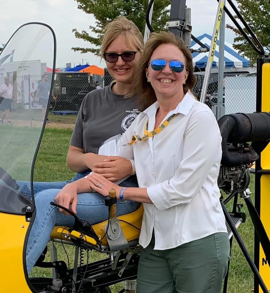 Krista and Beth Testing the feel of a gryocopter AirVenture 2019 Courtesy & © Beth Stanton