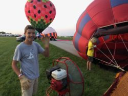 Fan Duty During Inflation Balloon glow event at OSH Airventure 2021 Hawk display Courtesy & © Bruce Erickson, Photographer